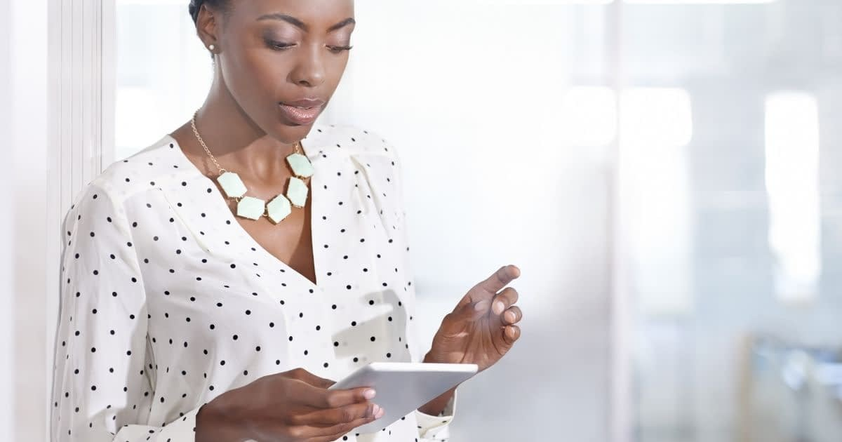 Small business owner leveraging sales automation tools via a tablet